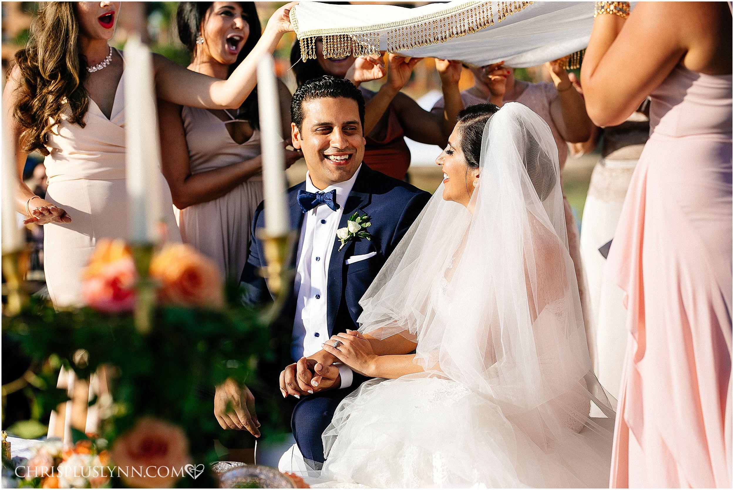 Cabo del Sol Wedding | Bride and Groom laugh during ceremony
